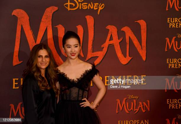Niki Caro and Yifei Liu attend the Mulan photocall at Trafalgar Hotel on March 13 2020 in London England