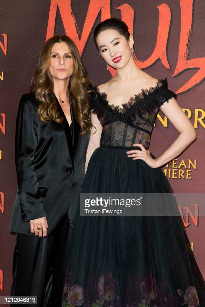Niki Caro and Yifei Liu attends the Mulan European Premiere at Odeon Luxe Leicester Square on March 12 2020 in London England