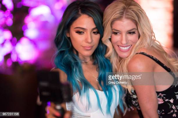 Niki DeMartino and Rebecca Zamolo take a selfie at the Niki Gabi DeMartino X Bellami Collection Launch Party at Avenue on May 10 2018 in Los Angeles...
