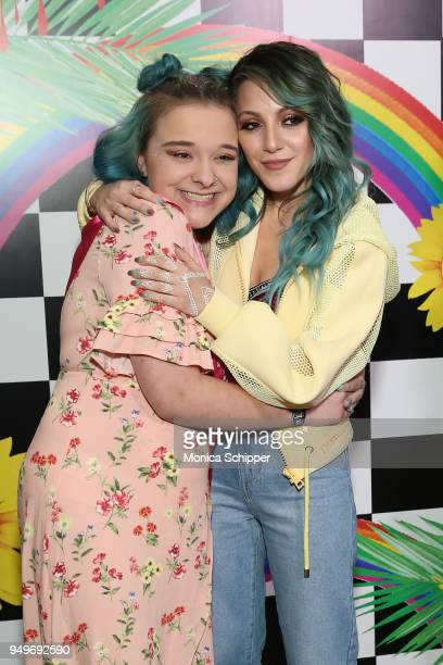 Niki DeMartino poses with a fan at a Meet Greet during Beautycon Festival NYC 2018 Day 1 at Jacob Javits Center on April 21 2018 in New York City