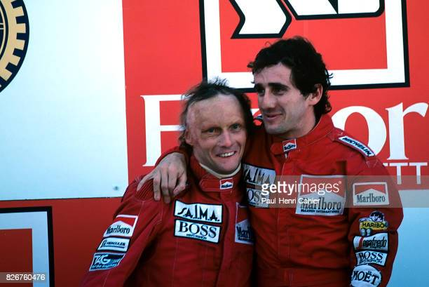 Niki Lauda, Alain Prost, Grand Prix of Portugal, Estoril, 21 October 1984. Niki Lauda and Alain Prost on the podium, brothers in arms after the...