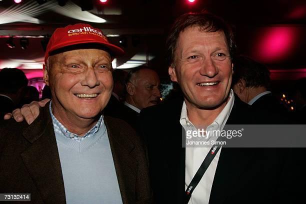 Niki Lauda and Austrian skilegend Franz Klammer attend the Kitzrace Party January 27 in Kitzbuehel Austria