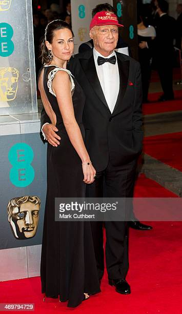 Niki Lauda and Birgit Lauda attend the EE British Academy Film Awards 2014 at The Royal Opera House on February 16 2014 in London England