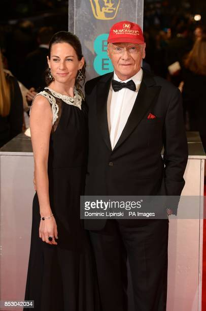 Niki Lauda and Birgit Wetzinger arriving at The EE British Academy Film Awards 2014 at the Royal Opera House Bow Street London