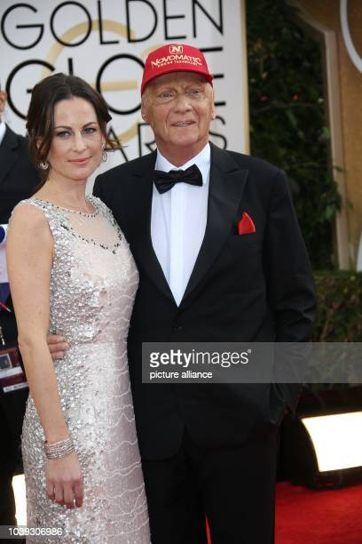 Niki Lauda and wife Birgit Wetzinger attend the 71st Annual Golden Globe Awards aka Golden Globes at Hotel Beverly Hilton in Los Angeles USA on 12...