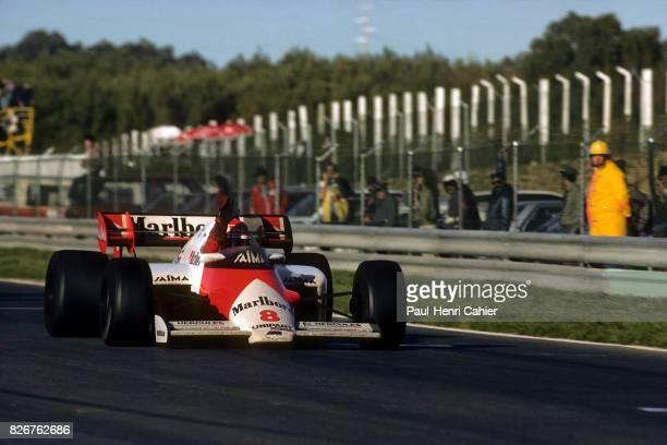 Niki Lauda, McLaren-TAG MP4/2, Grand Prix of Portugal, Estoril, 21 October 1984. Niki Lauda waves his hand as he crosses the finish line, clinching...