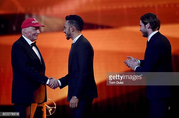 Niki Lauda MercedesBenz Motorsport NonExecutive Chairman with his Laureus Lifetime Achievement Award shakes the hand of Formula 1 driver Lewis...