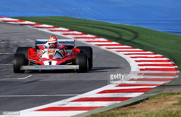 Niki Lauda nonexecutive chairman of Mercedes GP drives during a legends' race after qualifying ahead of the Austrian Formula One Grand Prix at Red...