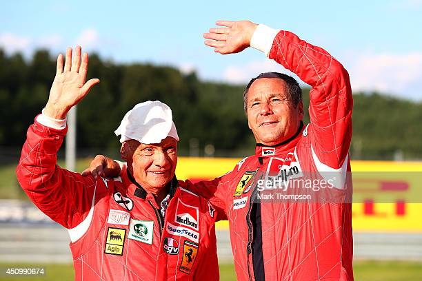 Niki Lauda nonexecutive chairman of Mercedes GP poses with former driver Gerhard Berger after qualifying ahead of the Austrian Formula One Grand Prix...