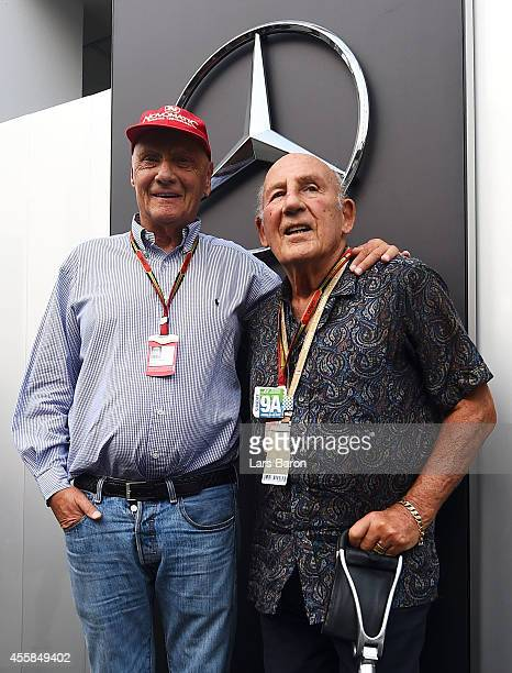 Niki Lauda nonexecutive chairman of Mercedes GP poses with Sir Stirling Moss before the Singapore Formula One Grand Prix at Marina Bay Street Circuit...