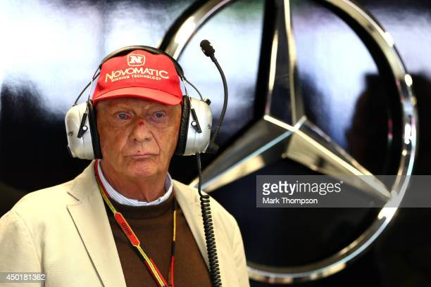Niki Lauda nonexecutive chairman of Mercedes GP watches the action from the Mercedes garage during practice ahead of the Canadian Formula One Grand...