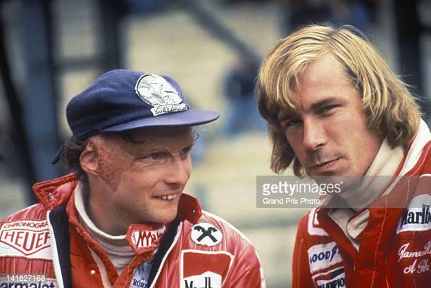 Niki Lauda of Austria, driver of the Ferrari SpA Ferrari 312T2 Ferrari flat-12 talks to rival James Hunt, driver of the MarlboroTeam McLaren M26 Ford...
