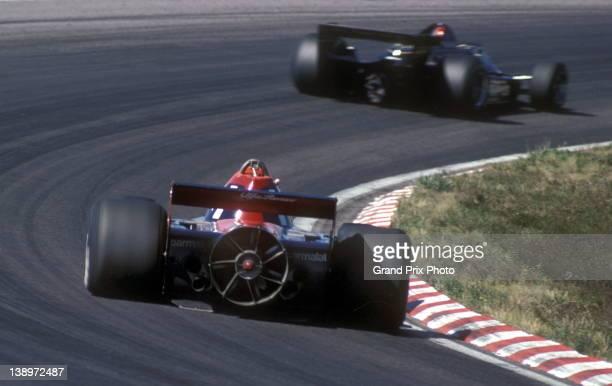Niki Lauda of Austria drives the Parmalat Racing Team Brabham BT45B Alfa Romeo flat-12 Fan Car in pursuit of Mario Andretti driving the John Player...