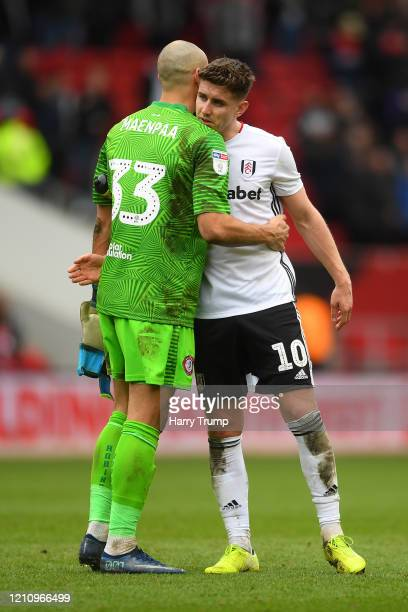 Niki Maenpaa of Bristol City and Tom Cairney of Fulham embrace each other following their draw in the Sky Bet Championship match between Bristol City...