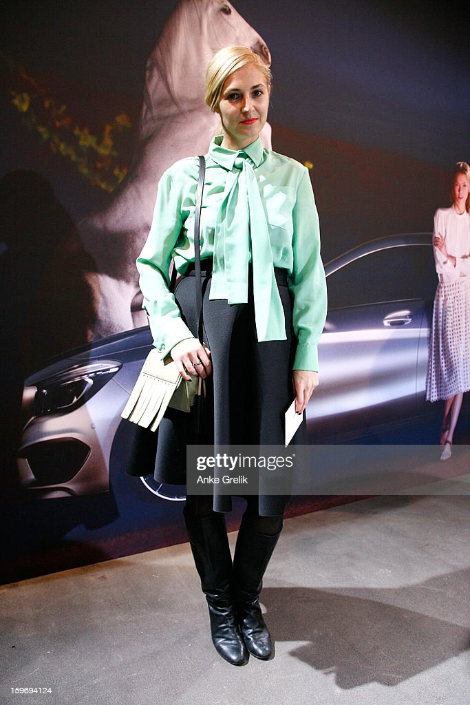 Niki Pauls wearing Chloe blouse, Acne bag and Maison Martin Margiela boots attends Mercedes-Benz Fashion Week Autumn/Winter 2013/14 at the Brandenburg Gate on January 18, 2013 in Berlin, Germany.