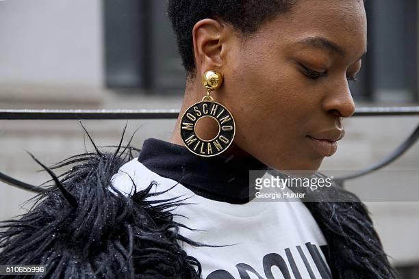 Niki Sha seen at Skylight at Moynihan Station outside the Jeremy Scott show wearing Moschino outfit with statement earrings during New York Fashion...