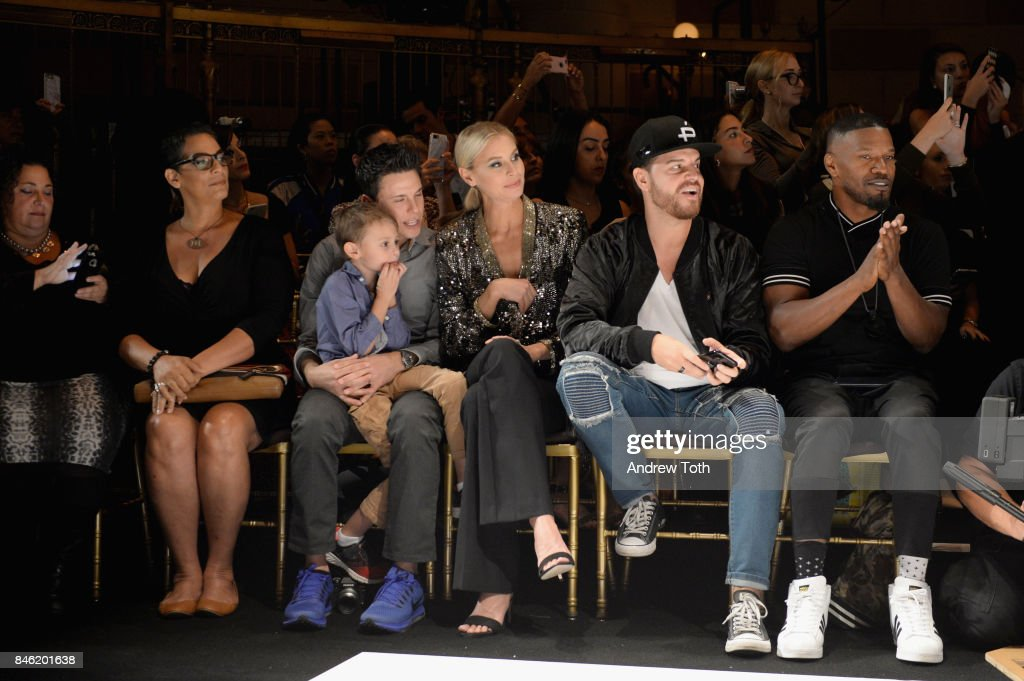 Niki Taylor (C) and Jamie Foxx (R) attends the Sherri Hill NYFW SS18 Runway Show at Gotham Hall on September 12, 2017 in New York City.