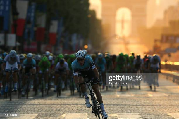 Niki Terpstra of Omega Pharma-Quickstep jumps off the front of the group during the twenty first and final stage of the 2013 Tour de France, a...