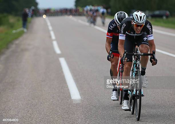 Niki Terpstra of The Netherlands and the Omega Pharma - Quick-Step Cycling Team and Sylvain Chavanel of France and IAM Cycling work together as they...