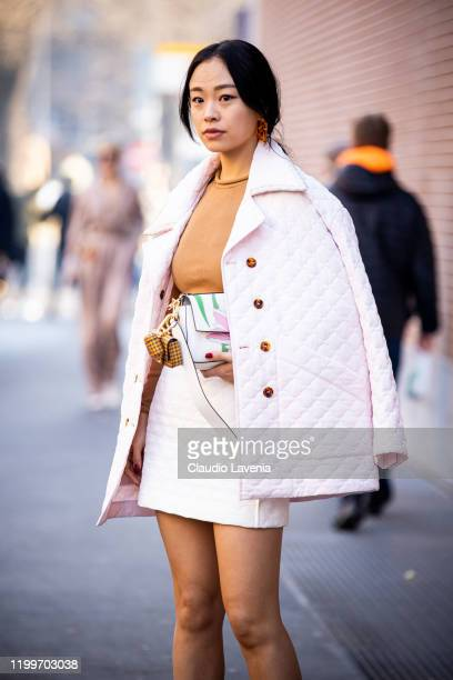 Niki Wu Jie wearing a beige top and light pink mini skirt with matching jacket is seen outside the Fendi show during the Milan Men's Fashion Week on...