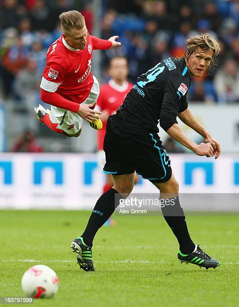 Niki Zimling of Mainz is challenged by Jannik Vestergaard of Hoffenheim during the Bundesliga match between TSG 1899 Hoffenheim and 1 FSV Mainz 05 at...