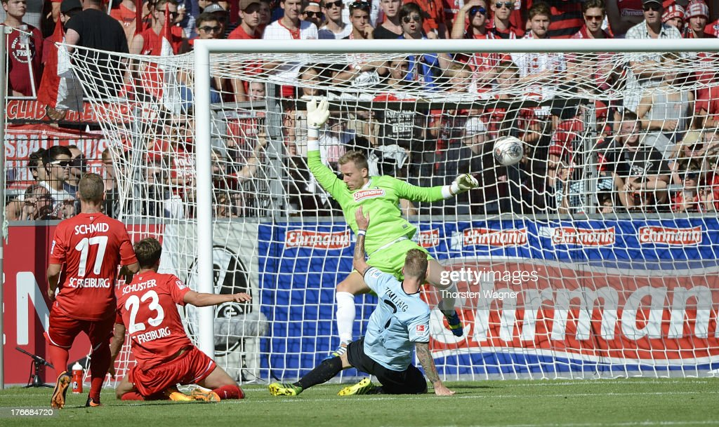 Niki Zimling of Mainz is scoring the opening goal during the Bundesliga match between SC Freiburg and FSV Mainz 05 at MAGE SOLAR Stadium on August 17, 2013 in Freiburg im Breisgau, Germany.