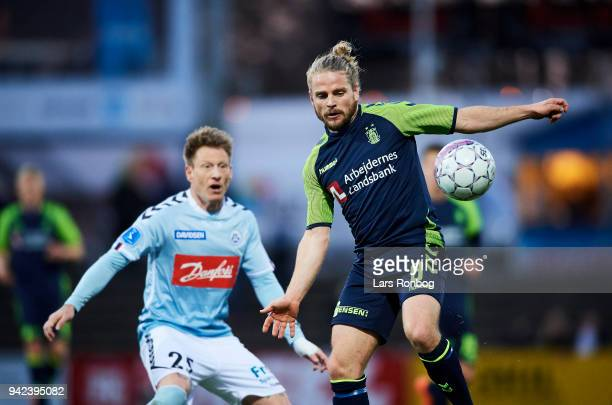 Niki Zimling of Sonderjyske and Kasper Fisker of Brondby IF compete for the ball during the Danish DBU Pokalen Cup quarterfinal match between...