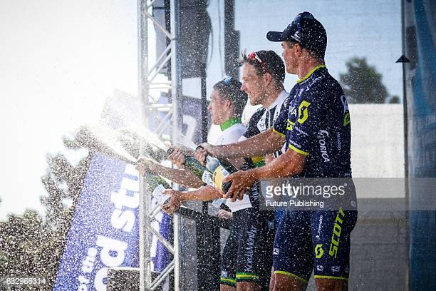 Nikias Arndt of Team Sunweb Simon Gerrans of Orica Scott and Cameron Meyer of Korda Mentha Real Estate spray champagne after the 2017 Cadel Evans...