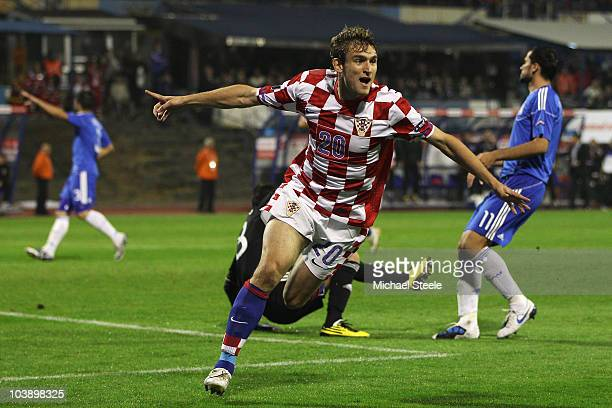 Nikica Jelavic of Croatia celebrates a goal only for it to be disallowed for offside during the EURO 2012 Qualifying Group F match between Croatia...