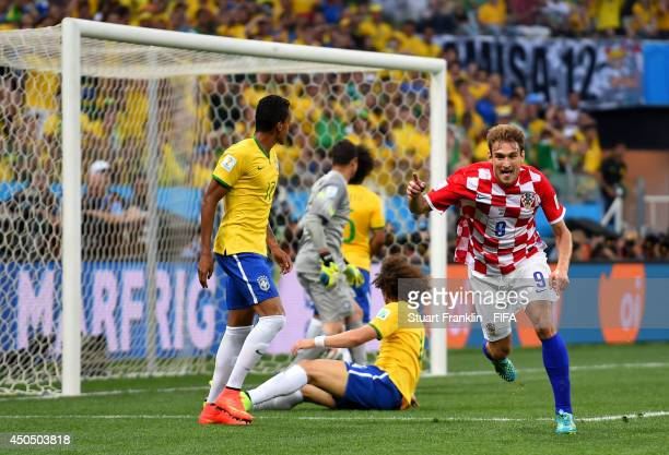 Nikica Jelavic of Croatia celebrates after his shot came off Marcelo of Brazil to score an own goal during the 2014 FIFA World Cup Brazil Group A...