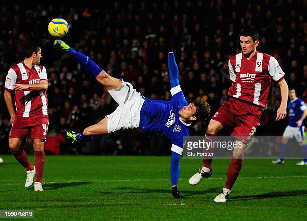 Nikica Jelavic of Everton attempts an overhead kick as Billy Jones of Cheltenham Town looks on during the FA Cup with Budweiser Third Round match...