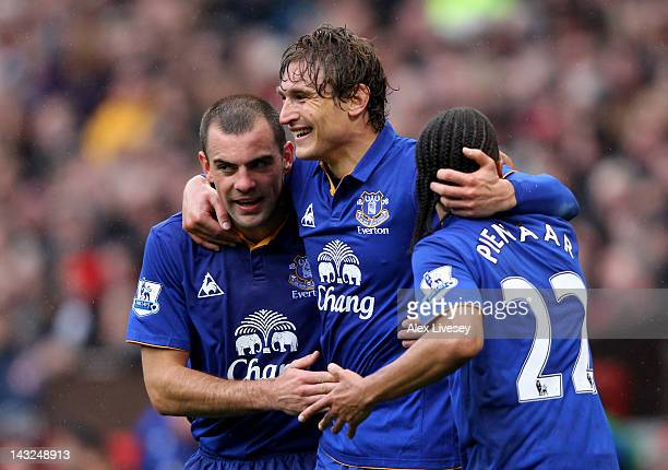 Nikica Jelavic of Everton celebrates scoring the opening goal with team mates Darron Gibson and Steven Pienaar during the Barclays Premier League...