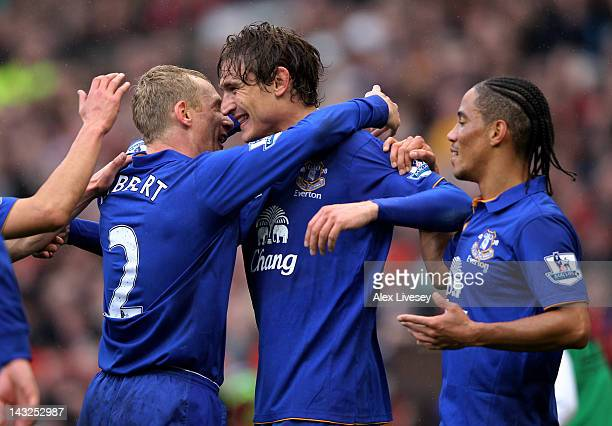 Nikica Jelavic of Everton celebrates scoring the opening goal with team mates Tony Hibbert and Steven Pienaar during the Barclays Premier League...