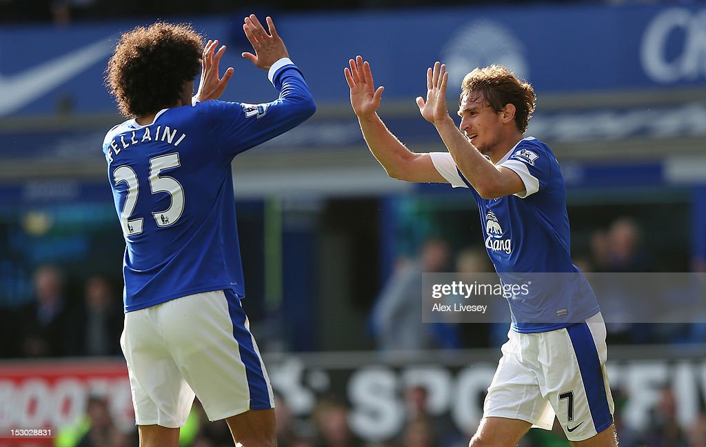 Nikica Jelavic of Everton celebrates with Marouane Fellaini after scoring his second goal during the Barclays Premier League match between Everton and Southampton at Goodison Park on September 29, 2012 in Liverpool, England.