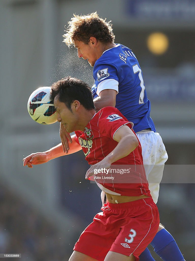 Nikica Jelavic of Everton challenges Maya Yoshida of Southampton for the ball during the Barclays Premier League match between Everton and Southampton at Goodison Park on September 29, 2012 in Liverpool, England.