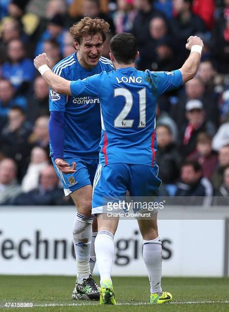 Nikica Jelavic of Hull celebrates with team mate Shane Long after scoring the team's second goal during the Barclays Premier League match between...