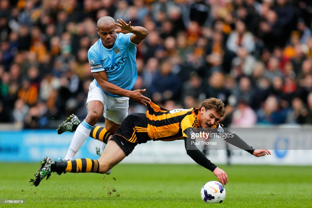 Nikica Jelavic of Hull City is brought down by Vincent Kompany of Manchester City during the Barclays Premier league match between Hull City and Manchester City at KC Stadium on March 15, 2014 in Hull, England. Kompany was shown the red card for this chalenge.