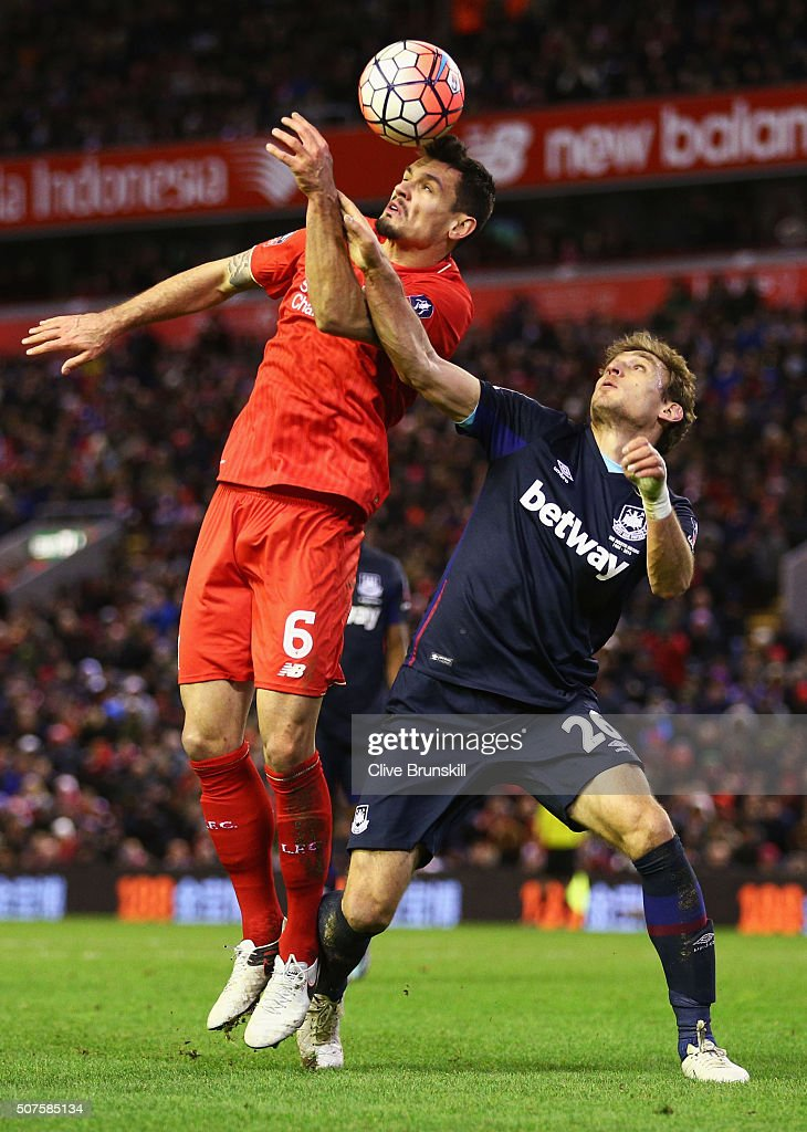 Nikica Jelavic of West Ham United battles with Dejan Lovren of Liverpool during the Emirates FA Cup Fourth Round match between Liverpool and West Ham United at Anfield on January 30, 2016 in Liverpool, England.