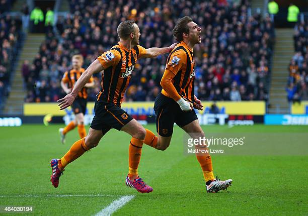 Nikica Jelevic of Hull City celebrates with David Meyler as he scores their first goal during the Barclays Premier League match between Hull City and...