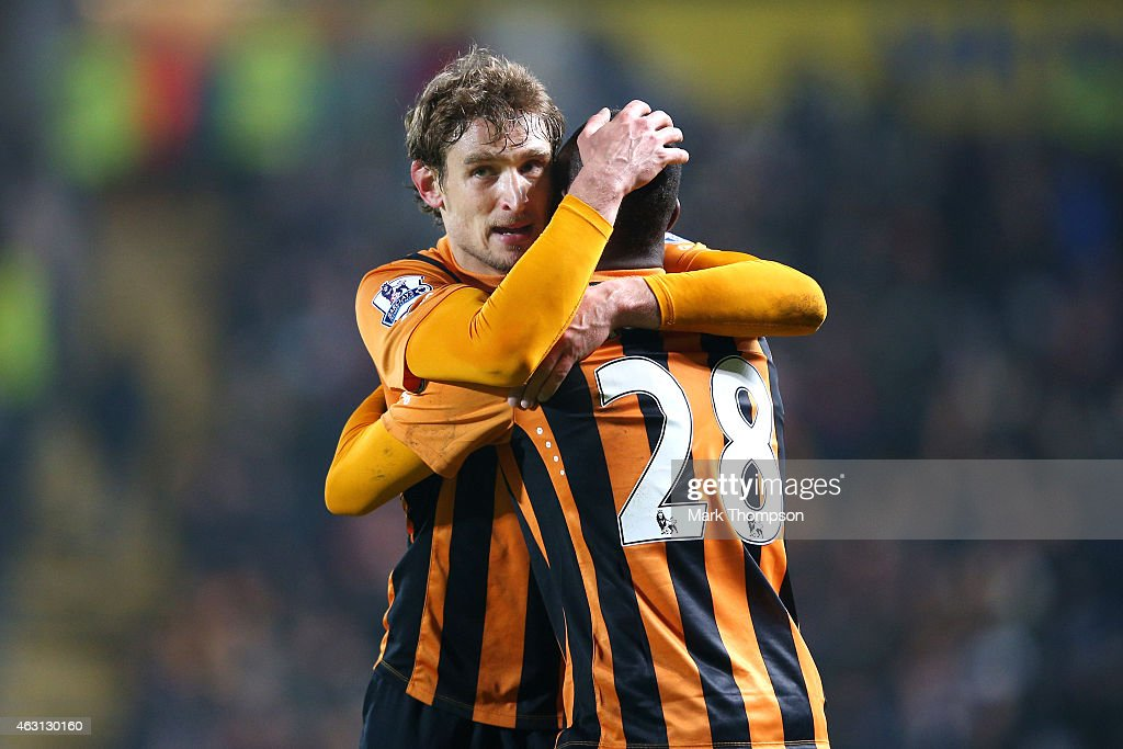 Nikica Jelevic (L) of Hull City is congratulated by teammate Dame N'Doye of Hull City after scoring the opening goal during the Barclays Premier League match between Hull City and Aston Villa at the KC Stadium on February 10, 2015 in Hull, England.