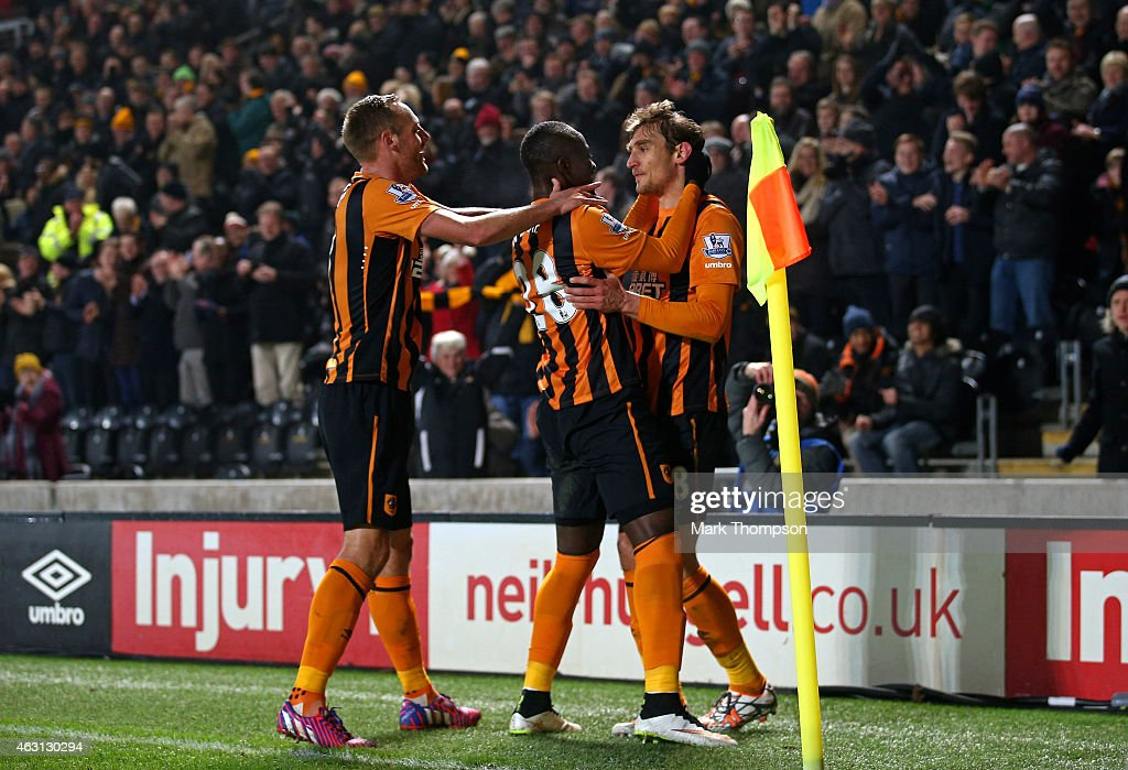 Nikica Jelevic of Hull City is congratulated by teammates Dame N'Doye and David Meyler of Hull City after scoring the opening goal during the Barclays Premier League match between Hull City and Aston Villa at the KC Stadium on February 10, 2015 in Hull, England.