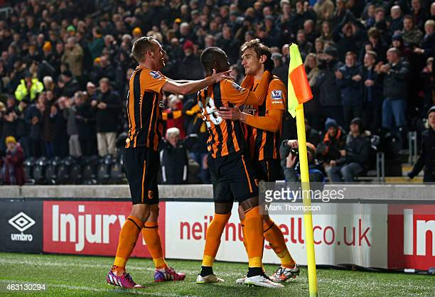 Nikica Jelevic of Hull City is congratulated by teammates Dame N'Doye and David Meyler of Hull City after scoring the opening goal during the...