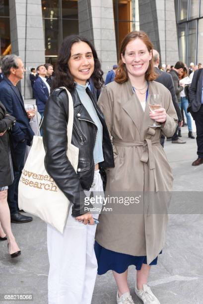 Nikima Jagudajuv and Julia Simpson attend The Shed First Reveal VIP Cocktail Party at The Shed on May 24 2017 in New York City