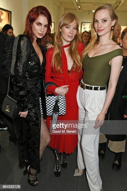 Nikita Andrianova guest and Dioni Tabbers attend a private view of photographer Ellen von Unwerth's exhibition Ladyland at Opera Gallery on May 3...