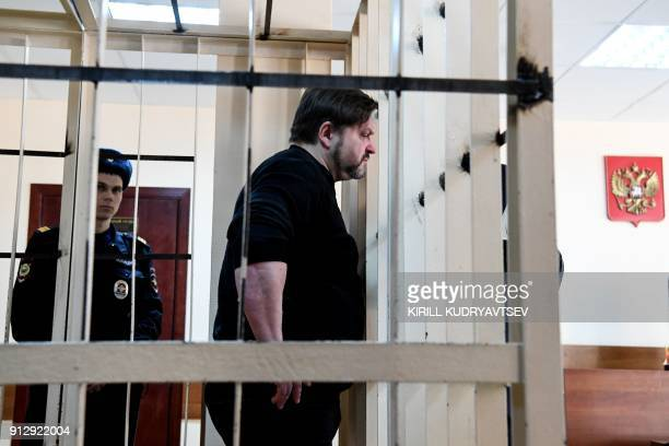 Nikita Belykh exKirov region governor stands inside defendants cage prior to a hearing at the Presnensky district court in Moscow on February 1 2018...