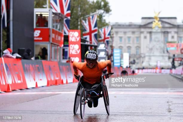 Nikita Den Boer of Netherlands crosses the line as she wins the Women's Wheelchair race during the 2020 Virgin Money London Marathon around St....