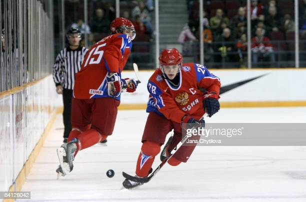 Nikita Filatov of Russia skates with the puck as team mate Evgeni Grachev looks on at the Civic Centre on December 26, 2008 in Ottawa, Ontario,...