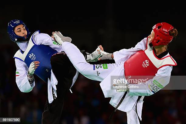 Nikita Glasnovic of Sweden competes against Kimia Alizadeh Zenoorin of the Islamic Republic of Iran during the Women's 57kg Bronze Medal Taekwondo...