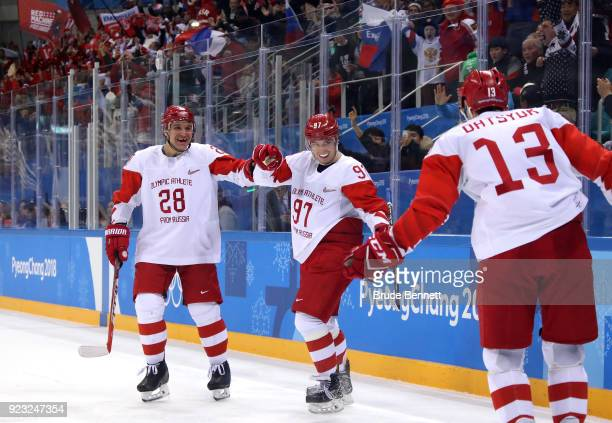 Nikita Gusev of Olympic Athlete from Russia celebrates with Andrei Zubarev and Pavel Datsyuk after scoring a goal in the second period against the...