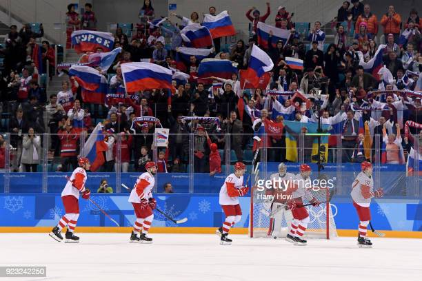 Nikita Gusev of Olympic Athlete from Russia celebrates with teammates after scoring a goal in the second period against Pavel Francouz of the Czech...